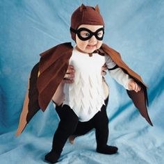 Our fledgling aviator gets his wings in the form of a felt baby owl costume.