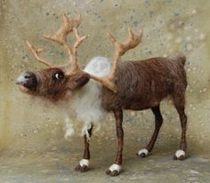 The first Reindeer of this season; he is about 7 at his shoulder and about 12 long. He is perfect next to my 12 Santa and Mrs. Claus. He is built onto a pose-able wire armature with cloven hooves and expansive antlers. I felted a little mischief right into his eyes.    Please contact me regarding international shipping.