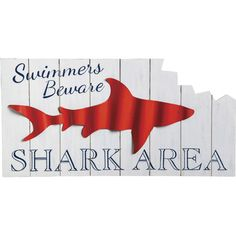 Featuring a shark silhouette and planked design, this whimsical wall decor offers deep-sea style to your den or home bar area.