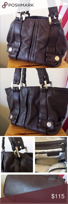 Michael kors Harness Grab Handbag A stunning Michael Kors dark brown purse. Good size, goes good with everything. Minor wear on the bottom corner, see last picture for detail. Overall in good condition. Michael Kors Bags Shoulder Bags