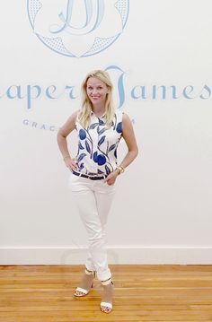 Reese Witherspoon At the Draper James Headquarters wearing draper james printed charlotte top and white jeans
