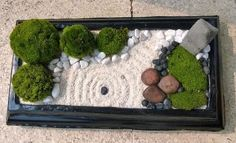 Although you can buy desktop Zen gardens in high end gadget stores like Brookstone and A Sharper Image, it's very simple and easy to make a desktop Zen garden.
