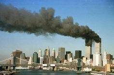 BBC News US & Canada: cancer victims to have treatment funded (Pic: The towers of the World Trade Center pour out smoke shortly after being struck by hijacked commercial airplanes in New York in this 11 September 2001 file photograph) Seattle Skyline, New York Skyline, 9 11 Anniversary, 11 September 2001, World Trade Center Attack, Creepy, We Will Never Forget, Illuminati, Photos