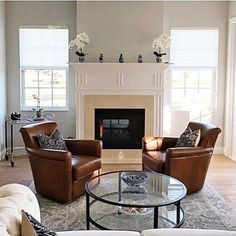 Our Design Services team in our Lehigh Valley Store deserves major props for this design.  It's a study in simplicity and symmetry using our Irving Swivel Lounge Chairs and Tanner Coffee Table.  Beautifully executed team! #prouddesignparents #newtrad #mypotterybarn #SwivelChair