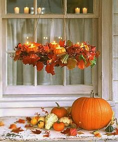 Pumpkin Chandelier, great idea for in front of a window outside.  Use electric candles and then no fire worries.