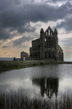 Whitby Abbey is a ruined Benedictine abbey overlooking the North Sea on the East Cliff above Whitby in North Yorkshire, England. Yet another ruin because of Henry VIII. Abandoned Churches, Abandoned Mansions, Abandoned Places In The Uk, Photo Post Mortem, Beautiful Buildings, Beautiful Places, Amazing Places, The Places Youll Go, Places To Go