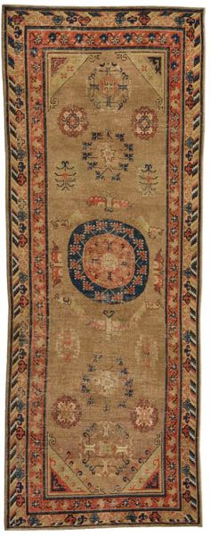 An early 20th century Samarkand (Khotan) rug, the tan field with various vinery formed roundels around a dark blue circle.