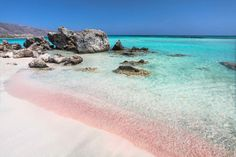 Elafonissi Pink Sand Beach • Crete, Greece. A pastel dream. When the tide is low, take a walk through the water from Crete to the tiny island of Elafonissi, where you can enjoy pink sands and waters straight out of a dream.