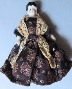 ANTIQUE DOLLHOUSE SIZE CHINA HEAD DOLL -  BISQUE ARMS AND LEGS