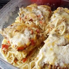 Baked Spaghetti I Recipe Main Dishes with spaghetti, onion, green bell pepper, lean ground beef, diced tomatoes, mushrooms, dried oregano, shredded mild cheddar cheese, condensed cream of mushroom soup, water, grated parmesan cheese