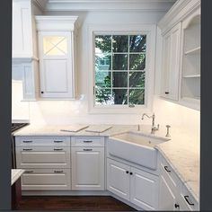 Love this corner apron farmhouse sink. The tree in front of the window is a