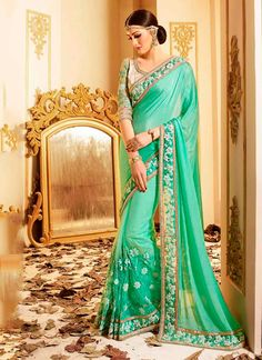 Sareebuzz: Honest to goodness class leaves your dressing style with this ocean green extravagant fabric designer saree. Improved with weaved and patch outskirt work all synchronized exceptionally well with the pattern and outline of the clothing. Accompanies coordinating pullover.