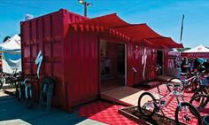 How the Container Allliance finds new uses for retired Shipping Containers - bike displays, housing and more.