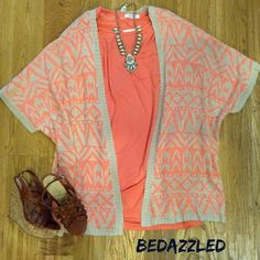 Stop in today for this cute outfit!  Coral tunic $26.99 small-large Aztec cardigan $28.99 small-large  Wedges $28.99 Necklace $28.99 #bedazzledokc