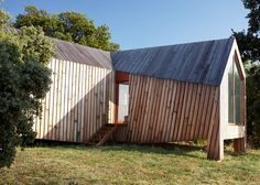 Angular timber volumes emanate from the centre of this wine-tasting pavilion in France.