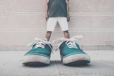 94e4405fa732 Optical Illusion Of Man Wearing Green Shoes Against Wall