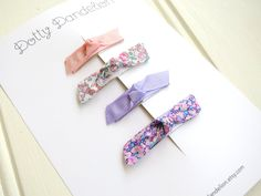 A gorgeous set of 4 tiny snap clips for your baby or toddler. Perfect for holding stray hair out of little ones eyes! The set includes: - 2 Grosgrain Ribbon Clips - 2 Liberty of London Fabric Clips. Each clip is lined with grosgrain ribbon, and measures 1cm by 5cm. Image on model is for size reference only. Handmade with love in Camden, NSW Australia. Please follow me on Instagram @dotty_dandelion I would love to see your girl wearing my bows! #dottydandelion Enter my shop here : : htt...