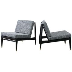 Pair of Mid-Century Modern Lounge Chairs | See more antique and modern Lounge Chairs at https://www.1stdibs.com/furniture/seating/lounge-chairs