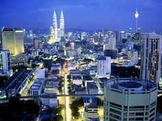 Spectacular view of Kuala Lumpur City Centre skyline during dusk hours. This view can be seen from Dynasty Hotel Kuala Lumpur at Jala. Malaysia Travel Guide, Malaysia Tour, Malaysia Truly Asia, World Famous Places, Places Around The World, Around The Worlds, Places To Travel, Places To See, Kuala Lumpur City