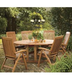 "7-Piece Eucalyptus Starburst Lazy Susan Table And Adjustable Chair Set  The top of our large round eucalyptus table features an in-grain starburst pattern with a flush-mounted rotating lazy susan for added convenience Size Table 70"" dia. x 28""H Chair 24""W x 26""D x 43""H $149.95 - $1499.95"