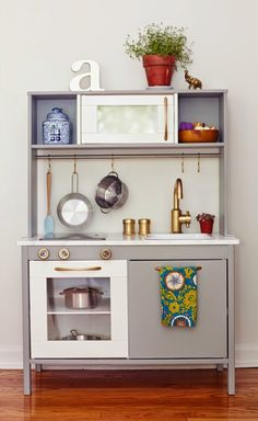 10 Inspiring Upgraded Play Kitchens. My real life, grown-up kitchen isn't even as nice as some of these DIY play kitchens that some very stylish parents have put together for their tiny tots. You might just find the kitchen design inspiration of your dreams from these playsets!