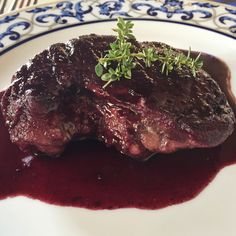 Pork chop cooked in Etna Rosso (wine).