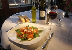 """Selected among the best restaurants in Loudoun for over 20 years, Tuscarora Mill Restaurant is a Loudoun institution. Known as """"Tuskie's"""" to locals, the restaurant has earned its reputation through its """"authentically local"""" experience felt in the ambience and décor, conveyed by the passionate staff, and evident in the quality cuisine.  Housed in a 19th century grain mill in historic downtown Leesburg, even the Tuskie's building honors Loudoun's agricultural history."""
