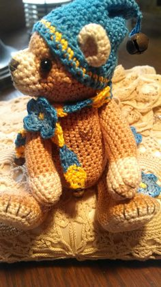 Forget-Me-Knot artist crochet thread teddy bear. This bear is crocheted with 100% cotton thread and stuffed with polyester fill. He is 4 1/2