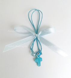 Greek Wedding Shop - Blue Bow Martyrika With Mati. Witness Pins for your godchild's baptism ceremony (http://www.greekweddingshop.com/blue-bow-martyrika-with-mati/)
