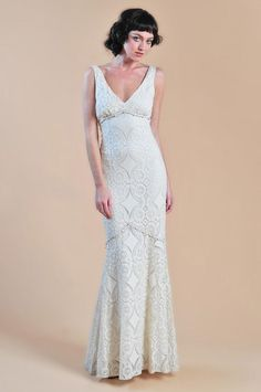 Natural and easy the MADELEINE wedding dress is an ecrucotton lace mermaid silhouette gown with grosgrain ribbon and buttons.The diamond pattern in the fabric
