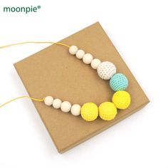 Yellow & Teal Crochet Nursing necklace - chewing beads - Breastfeeding Babywering necklace - Teething toy NW1799. Yesterday's price: US $8.19 (6.78 EUR). Today's price: US $8.19 (6.78 EUR). Discount: 18%.