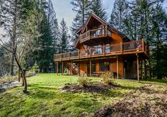 """49120 SE MIDDLE FORK ROAD, NORTH BEND Hear the river on your Mail Box Peak view deck, walk to the river on your private trail, co-owned 4.5 acres with 300 feet of magnificent riverfront. 3 Bedroom and 2.5 bathrooms, loft and family/office room. Beautiful Pan Abode like construction, (lamination's of Ponderosa Pine) 4"""" thick walls on Main and Upper floors."""