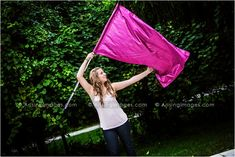 Always incorporate your hobbies, sports and interests in your senior pictures! Color Guard :)