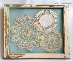 Display vintage doilies in a salvaged antique window frame