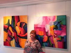 Di Elsden in the foyer of Tosari Galleries with  some of her abstracts