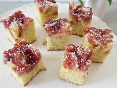 Sugar Plum White Chocolate Cake Bites - A sweet white chocolate cake with swirled sugar plum jam and dusted with powdered sugar.