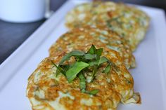 zucchini pancakes with tahini sauce. Sub some arrowroot powder or nutritional yeast for the eggs.