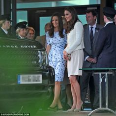 July 8, 2012 - Quick getaway: Kate and Pippa make their exit from centre court following the match.