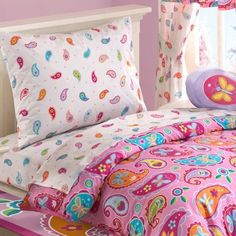 Paisley Dreams Toddler Sheet Set by By Olive Kids. $49.99. Imported.. material is machine washable.. Our Paisley Dreams bedding is a dream! Little girls will love this fanciful pink design. The top features swirling paisleys in vibrant colors with adorable bugs and flowers for a fun, modern twist! The reverse is a pink paisley and polka dot coordinate. Toddler Bedset-Toddler comforter set includes: Toddler comforter sized 42 in x 58 in 100% cotton. Toddler sheet se...