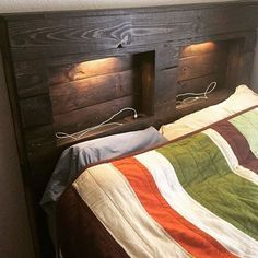 Reconditioned/Certified - Pallet queen headboard that was handmade, stained, and sealed. Has wiring for outlets that have 2 plugs as well as USB ports. Has led touch lights as well. Selling for $400 or best offer. Very heavy and made from quality pallet wood.