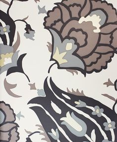 Turkish Flower Wallpaper A floral wallpaper featuring a large stylised tulip design printed in charcoal, taupe and beige on a pale cream background.