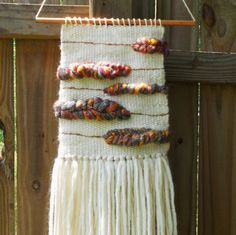This weaving was made on my lap loom with a beautiful, fiery roving yarn with other wool and cotton yarns. Master Bathroom