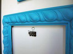 Add binder clips to the kids' art frames