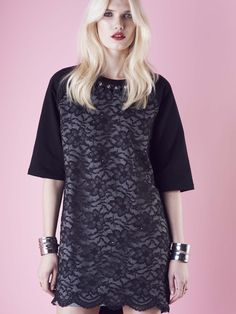 Model wears Naughty Dog ¾ sleeve fleece #dress doubled with lace and decorated with Swarovski crystals.
