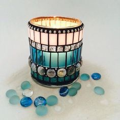 Add the perfect accent with this dramatic, luminous, mosaic candle votive in light blue and white stained glass, clear glass gems, teal glitter