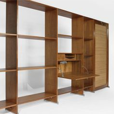 Hans Wegner LIVING UNIT comprising four shelving bays with a fall-front desk and a drop-down bed teak and cane 80 3/4 x 181 1/2 x 31 3/4 in. (205.1 x 461 x 80.6 cm) with desk open ca. 1960s manufactured by Getama, Denmark