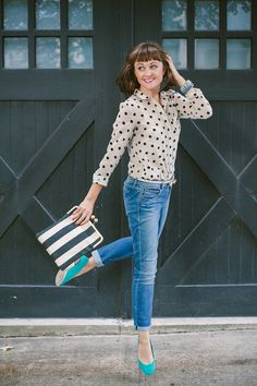 Polka dot blouse, striped clutch, and turquoise flats.