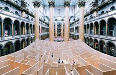 Bjarke Ingels Group (BIG) created a life-size indoor maze at the National Building Museum in Washington DC. Situated in the west court of the museum's great hall, the vast 18-foot high labyrinth is constructed from baltic birch plywood.