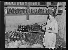 "7. ""Mrs. Bettenhausen with canned goods in cellar. McIntosh County, North Dakota"""