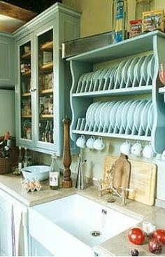 Large sink. Open dish storage.
